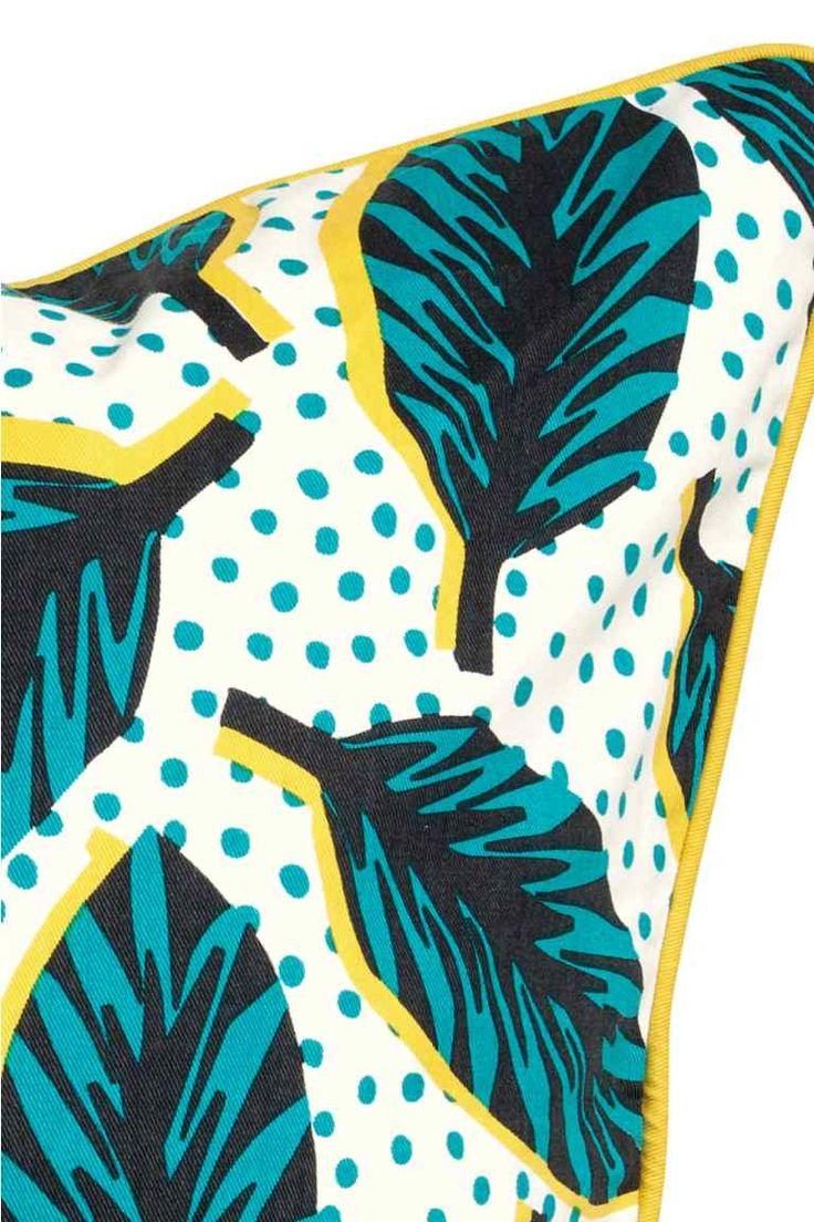 Housse de coussin à motif: Housse de coussin en twill de coton avec motif imprimé et passepoil de couleur contrastée. Fermeture à glissière dissimulée.