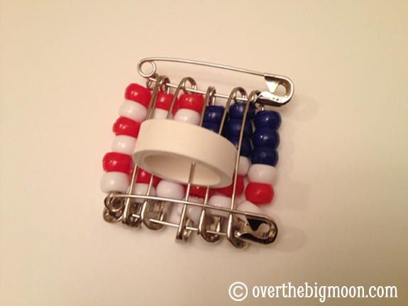 * American Flag Neckerchief Slide  -- what  you need per Neckerchief Slide:   8  2″ Safety Pins (Size 3), 9 BLUE Pony Beads, 12 RED Pony Beads, 15 WHITE Pony Beads, 1 – 3/4″ diameter PVC pipe cut approx 1/2″ thick