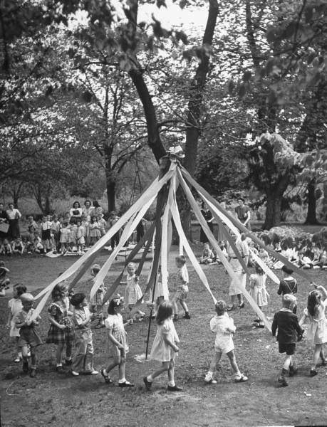 May Day ... memories of School Days: On May Day,we took small cupcake size or paper cups with treats in them to our friends at their house. We would ring the bell,or knock and run. The object being to take to boy friends who would try to catch and kiss you.