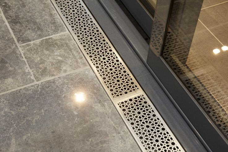 Integrated Level threshold drain system - Lateral Design Studio