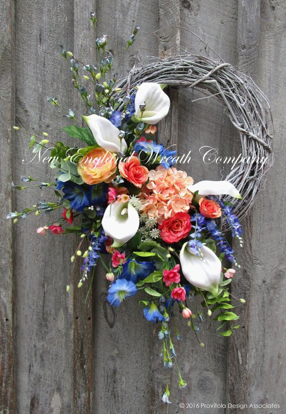 Calla Lily Garden Wreath. An absolutely stunning collection of Calla Lilies, Hydrangeas, Morning Glories, Roses and other garden favorites and wildflowers in rich, vibrant hues and soft pastels create