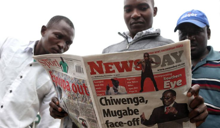Photo: Members of the public read a copy of a local newspaper in Harare, Zimbabwe, 15 November 2017. EPA-EFE/AARON UFUMELI