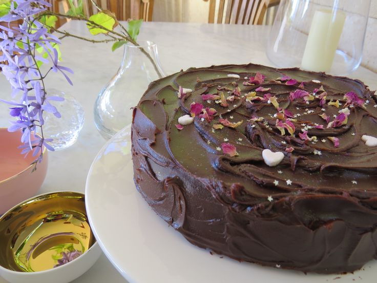 Decadent chocolate cake with edible rose petals