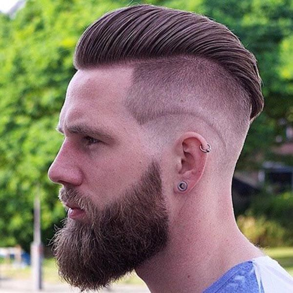 Raked Mohawk Comb Over with High-Low Fade