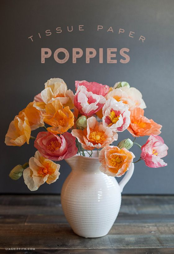 tissue paper poppies - DIY tutorial for an inexpensive party decoration: cute for birthday parties, baby showers, and wedding receptions