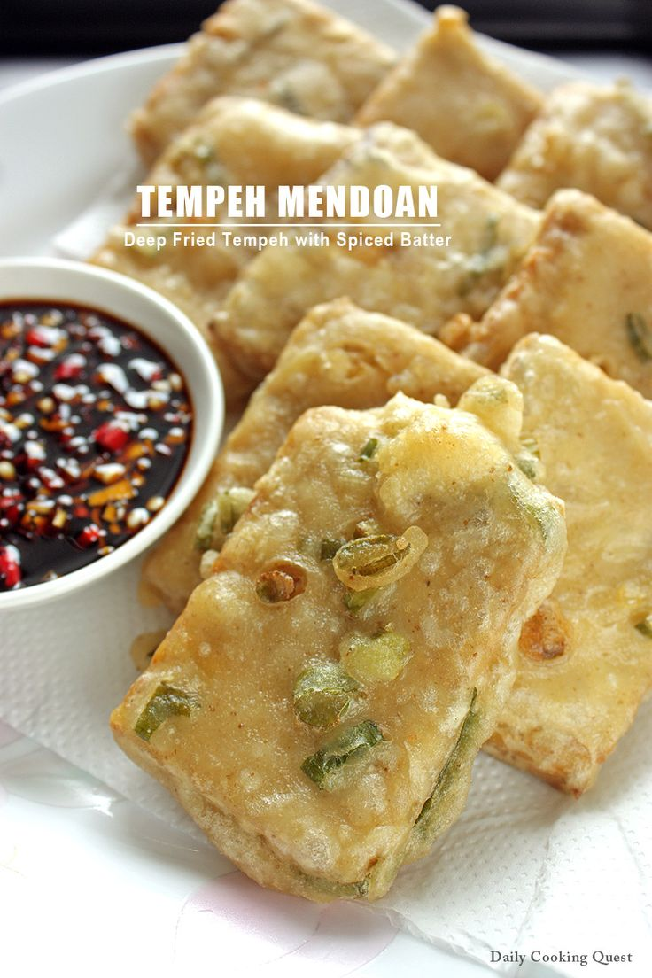 Tempeh Mendoan - Deep Friend Tempeh with Spiced Batter: Originated from the city of Purwokerto in Central Java, tempeh mendoan is a very popular street food, and for good reason. Unlike other tempeh dish, tempeh mendoan has a spiced batter coating. This coating, when deep fried, will be extra crispy yet the tempeh inside is still soft and tender … ^_^