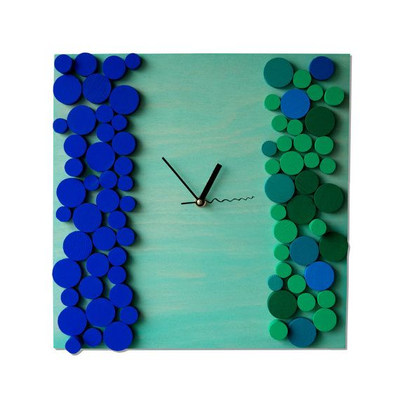Deco Oceanic Bubbles / Wood wall clock / Geometric mosaic / Unique design Liliana Stoica ▀▄ ▀▄ ▀▄ Collection - limited edition - Deco Clocks - spring 2014 - Massive wood cut in geometrical pattern, manual painted and assembled with an abstract vision for shapes and shadows. The