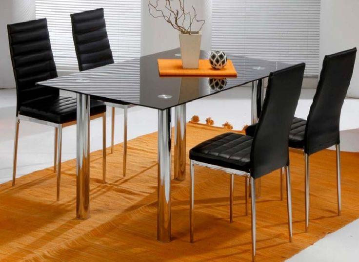 Pack Avat: Conjunto de mesa metálica, con tapa de cristal blanco o negro. Cuatro sillas metálicas tapizadas en negro o blanco. Se sirve en Kit de muy fácil montaje y con instrucciones claras. Cristal templado de 8mm. Estructura metálica con recubrimiento cromado. Patas con tapas de plástico antirrayado. Tapizado en PVC lavable.