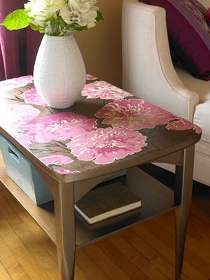 Make over a hand-me-down side table with decoupage. Paint the table with two coats of metallic paint and a coat of metallic glaze for extra shimmer. Let dry. Cut a scrap of wallpaper to fit the top. Coat the table with decoupage glue, position the paper, and cover it with several layers of decoupage glue. (Allow each coat to dry before applying the next.) Finish the top with a spray sealant.