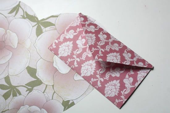 How cute! I have always wondered how to make a good envelope. And when you unfold it, its a heart!