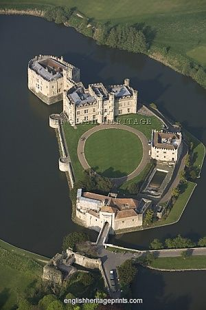 LEEDS CASTLE, Kent. Aerial view. First built in 1119, the castle became a royal palace for Edward I and Eleanor of Castile in 1278, who added the successive gatehouse defences of the barbican. It was later transformed by Henry VIII for Catherine of Aragon.