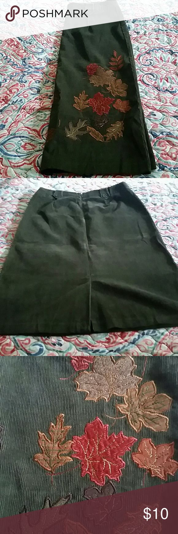 "Adorable corduroy skirt The skirt is adorable and perfect for your fall wardrobe. So cute with a pair of tall boots and cozy sweater. Like new condition. 100% cotton. Skirt with a dark olive green embroidery with reds, greens and golds. 27"" long Norton Studio Skirts"