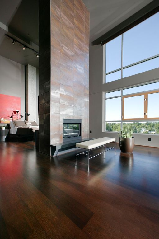 Modern Master Bedroom with Laminate floors, stone fireplace, metal fireplace, Design Within Reach Grissini Bench, Columns