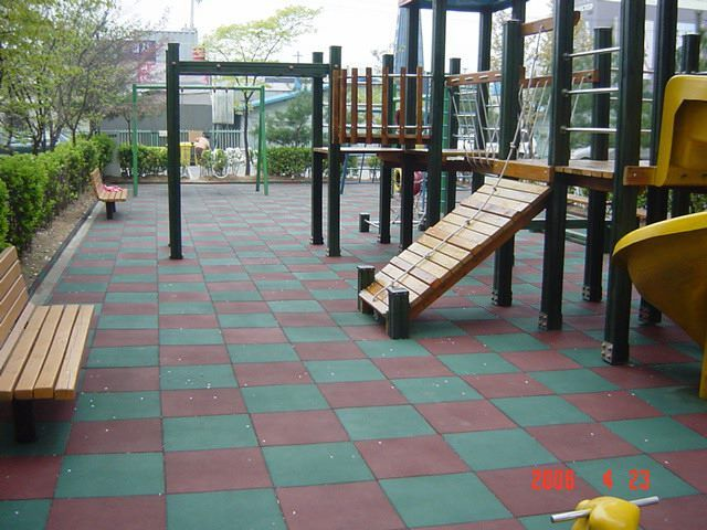 Square Rubber Tiles To provide an impact absorbing surface around and under play equipment. These surfaces are elastic, non-skid, porous and can withstand extreme weather as well as non-flammable and shock absorbent.
