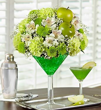 "Inspired by the popular Irish cocktail, our Green Dublin Apple Floral Cocktail is arranged with fresh green carnations, poms, and alstreomeria! Accented with green apple picks, this flower cocktail will certainly ""stir up"" St. Patrick's Day smiles!   Deal of the Week! Save up to 33% on Sweet Spring Lilies, Over 50 Blooms, just $29.99! (Reg. $44.99). Order Now at 1800flowers.com (Offer Ends 03/15 or While Supplies Last) http://www.planetgoldilocks.com/flowers.htm #flowers #roses #bouquets…"