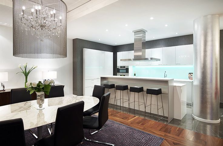 Beautiful LED-lit backsplash of the kitchen draws your attention instantly