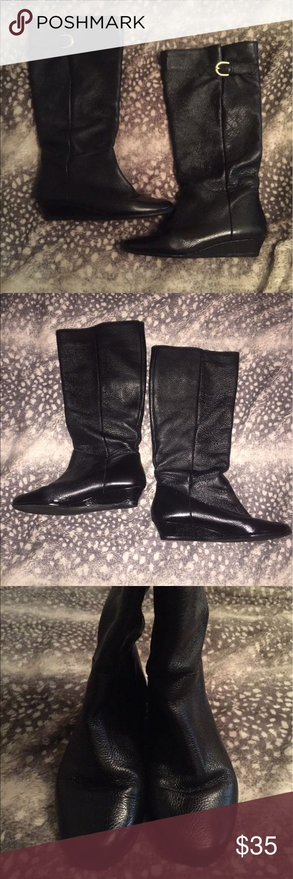Steve Madden Size 7 Black Intyce Boots Women's size 7, black textured leather wedge boot with gold side-buckle. The side buckle strap has 3 holes to adjust to fit your calf. The leather is soft / flexible, so they tend to slouch on me, but the might stand up if your leg fills them out more. They look good either way though. I just had them re-soled at the cobbler and have not worn them since. Great, comfy, everyday boot. Steve Madden Shoes Heeled Boots