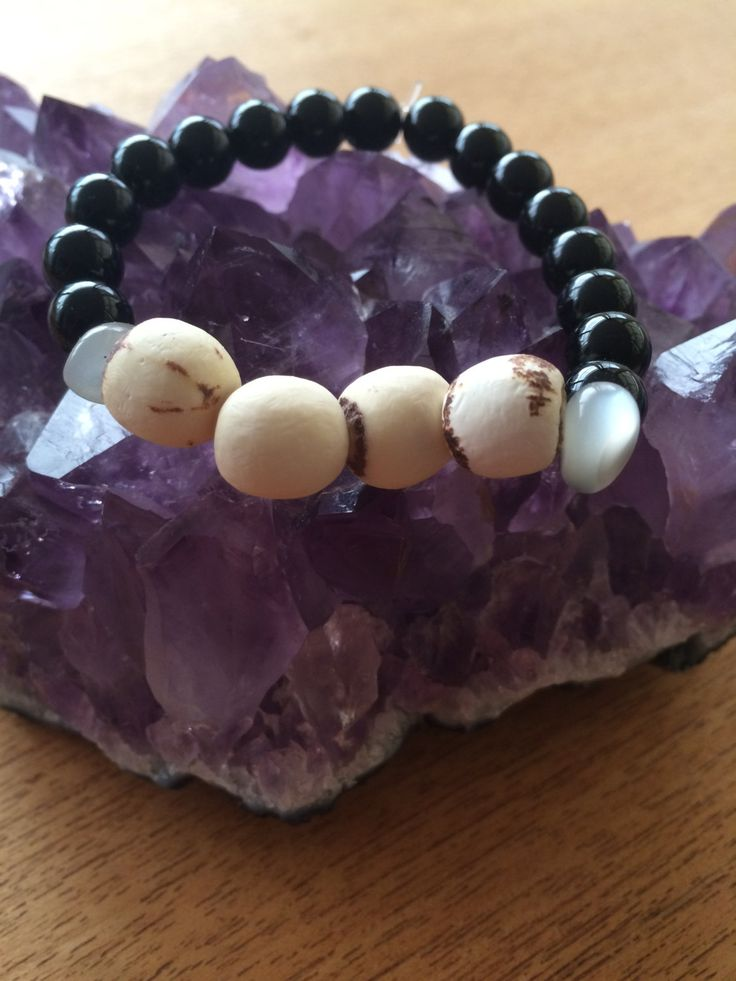 crystal bracelet with lotus seed by wellbeingbliss on Etsy