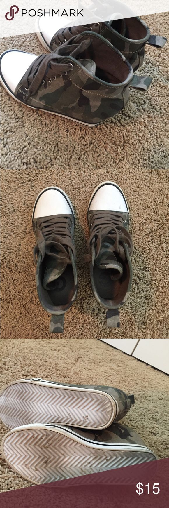 Guess size 6.5 wedge tennis shoe Gently used. Worn multiple times. Only a few black marks (see pics). Camouflage print wedge tennis shoe. Super comfortable. Guess Shoes Wedges