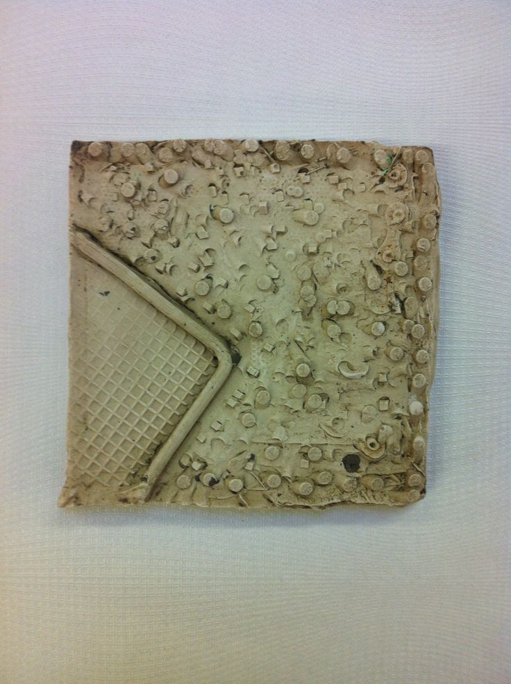 Plaster tile of road drain/grid, inspired by the Boyle Family.