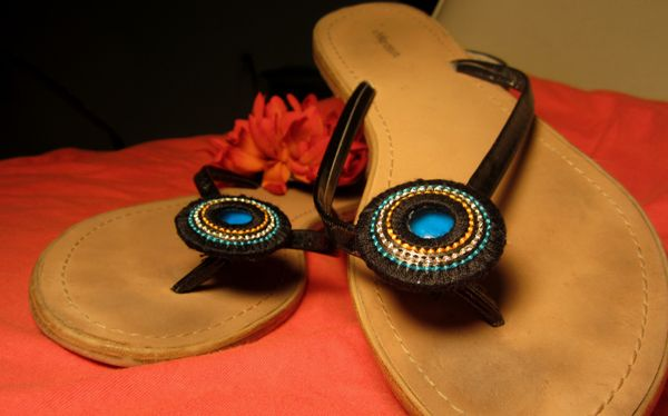 The decorations on these sandals are made from K-Cup filters!  Here's how to make your own cute K-ickers:  Shades Of Tangerine: Bohemian Sandals- From K-Cup Filters (DIY)