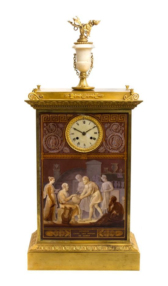 An Empire Gilt Bronze and Porcelain Mantel Clock  19th century  having a circular dial with Roman numerals, within a rectangular case surmounted by a flowering urn finial above porcelain plaques depicting a Homerian scene titled 'Homere chez les potiers de Samos'.  Height overall 28 1/4 inches.