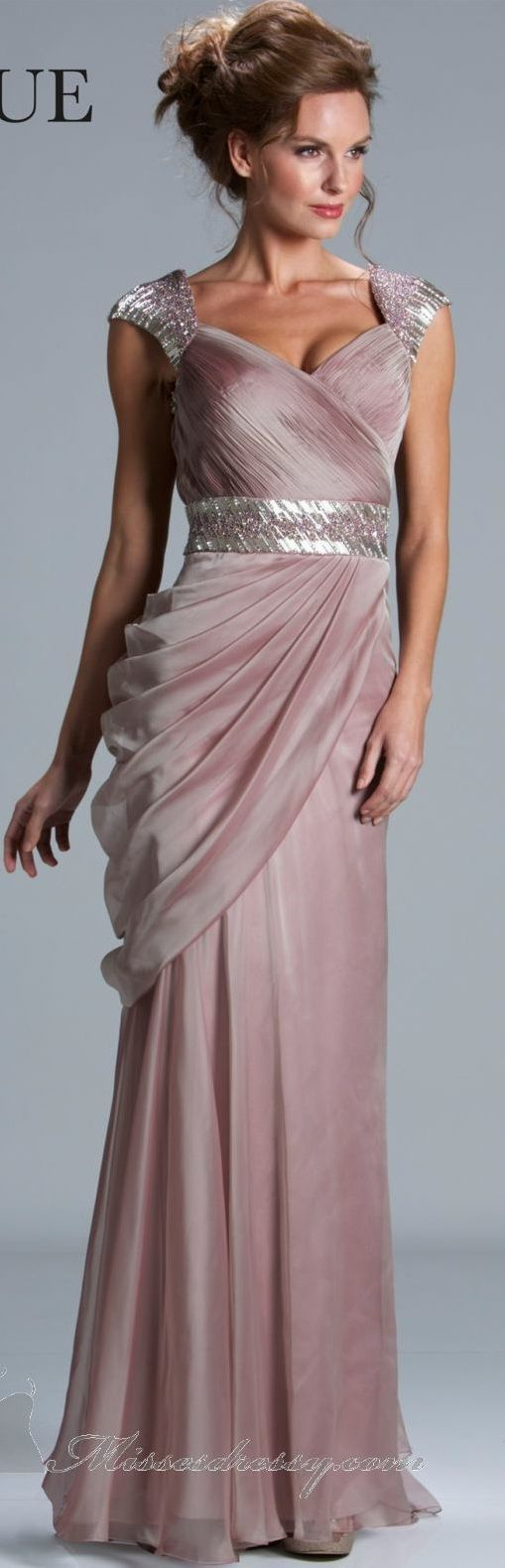 Janique couture ~ If this was white this would make a real pretty wed. dress.