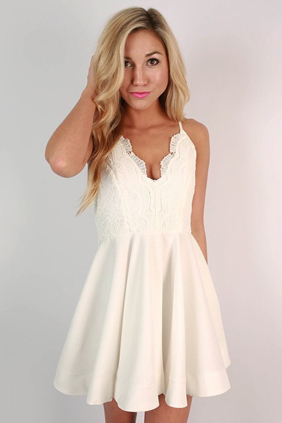 The fit and flare style is so flattering, and this adorable white mini is the perfect example!