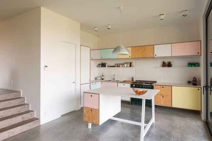 Kitchen with pastel cupboards. I love these colours.