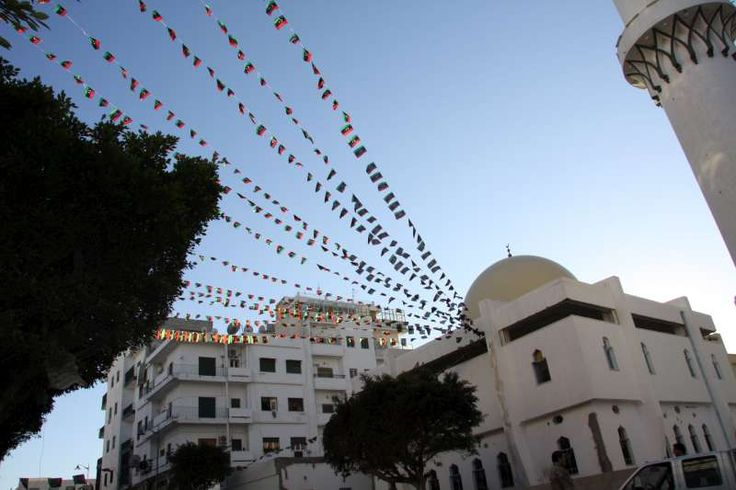 Strings of Libya's new flag flutter from a mosque in Tripoli a year after people rose against the former regime. But many displaced people were not celebrating.  ©UNHCR/L.Dobbs