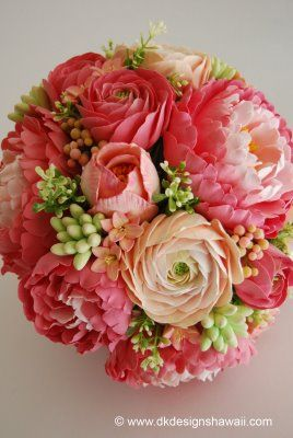 Coral pink peonies in varying shades, ranunculus in coral pink and peach tones, hyacinth in peach with pink edged petals, tuberose buds with a peach hue, and tulips