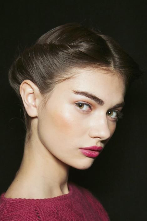 Berry lips, bronzer not blush, bold brows, and chic, tamed hair