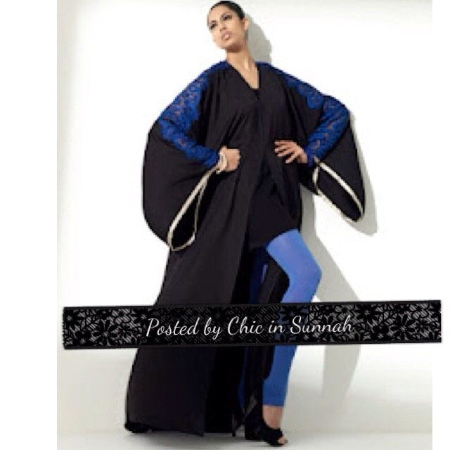 Abaya. Arabesque. Black with electric blue lace details. Open front.