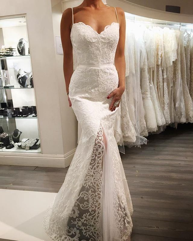 Caleche Trunk Show hosted by Raffaele Ciuca Bridal. Gorgeous Lace slinky wedding dress with front slit.