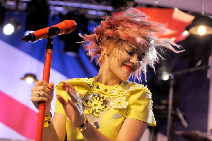 Rita Ora whips her hair back and forth during a performance at the iHeartRadio Live: UK Rocks series on Oct. 17 in New YorkPhotos