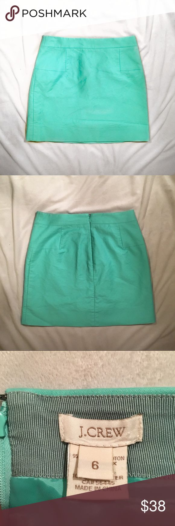 J. Crew teal mini skirt J. Crew turquoise mini skirt! Perfect to spring, especially Easter! In great condition! Only one flaw: there's tiny light blue pen mark. A few on the front and back. I pictured the ones on the back. There's a zipper down the back of the skirt.   Width: almost 15 inches Length 16.5 inches J. Crew Skirts Mini