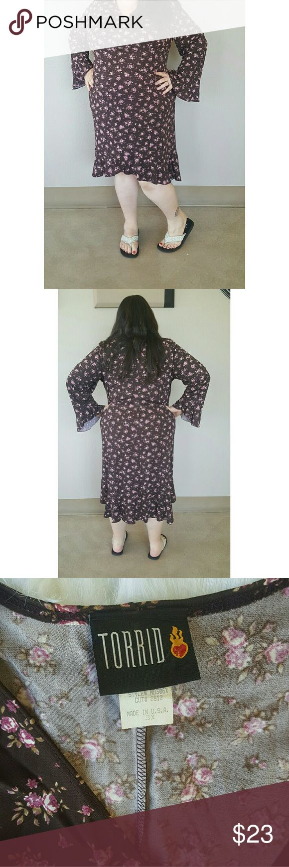 Boho Torrid Dress Gorgeous boho style dress. Torrid plus size 3X. Super flattering. Trendy bell sleeve, floral pattern and high low hem. Older Torrid but in great used condition. Perfect for spring and summer and festivals! torrid Dresses