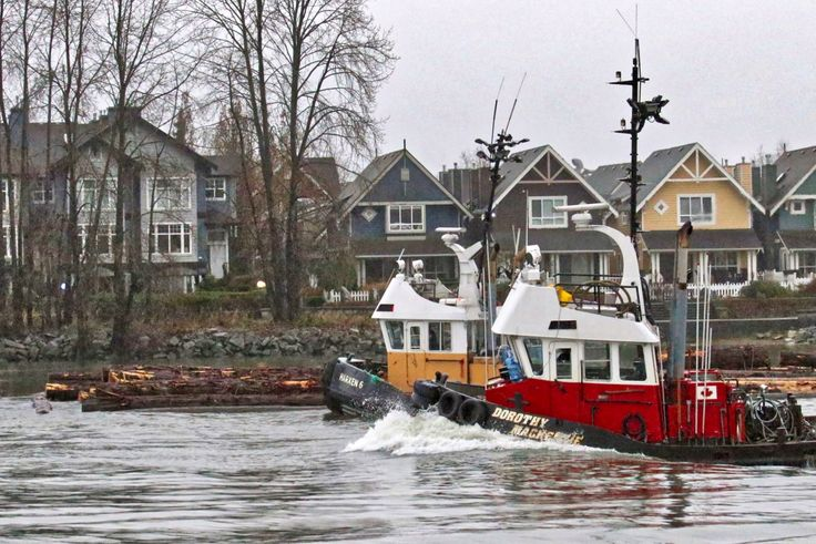 "Harken Towing's tugboats ""Harken 6"" and ""Dorothy Mackenzie"" guide a log boom in the North Arm of the Fraser River. Click image to enlarge."