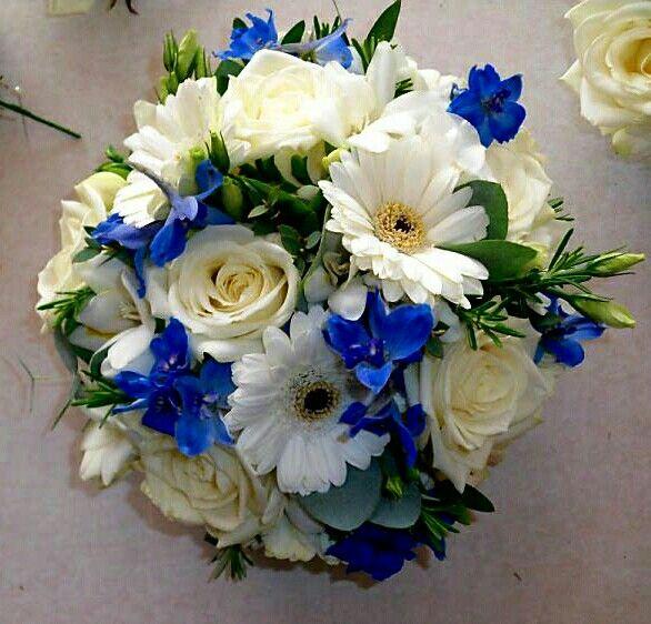 Blue Delphinium, White Roses, White Gerbera Daisies, Green Eucalyptus Wedding Bouquet