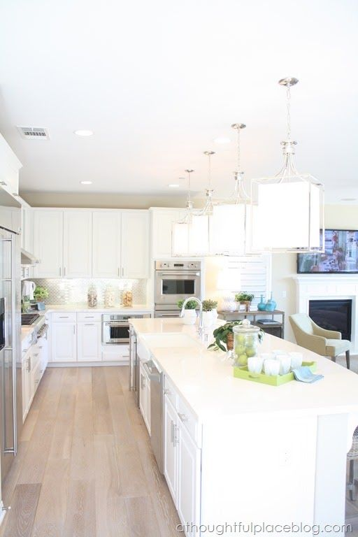 White Counters Cabinets Pale Wood Floors