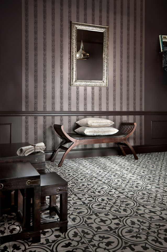 Moroccan inspired eclectic interior. In he floor are cement tiles and on  wall is Farrow&Ball