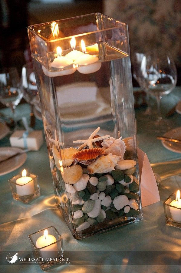 Floating candles at a beach themed reception @Laura Jayson Jayson Jayson Haskenhoff -- use all those vases.. instead of all those flowers. simple and cute.
