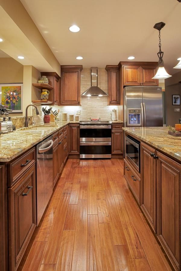 Visual Spaces On The Wooden Kitchen Cabinet With Images Brown Kitchen Cabinets Wooden Kitchen Cabinets Kitchen Renovation