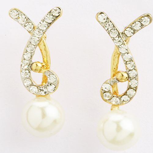 A beautiful combination of #gold, American #diamonds, and #pearls to make these perfect #earrings set for your #loved ones. An ideal wear for any occasion. Visit:- http://www.ghasitaramgifts.com/c/all/mothers-day-2017/earing/