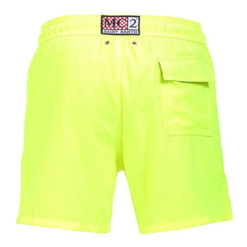 "FLUORESCENT YELLOW OWNER P SWIM SHORTS WITH SKULL Fluorescent yellow Long Swim Shorts featuring a skull and ""PIRATES DE SAINT BARTH"" embroidery at lateral side. Two front pockets and back Velcro pocket. Internal net. Elastic waistband with adjustable drawstring. COMPOSITION: 100% POLYESTER. Model wears size M, he is 189 cm tall and weighs 86 Kg."
