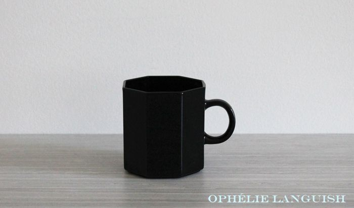 "Edgy set of sleek black tempered glass Arcoroc mugs with hip geometric styling. Eight sided (octagonal) in the Octime pattern. Stamped with ""FRANCE"" on the bottom. Retro, yet refreshingly modern."
