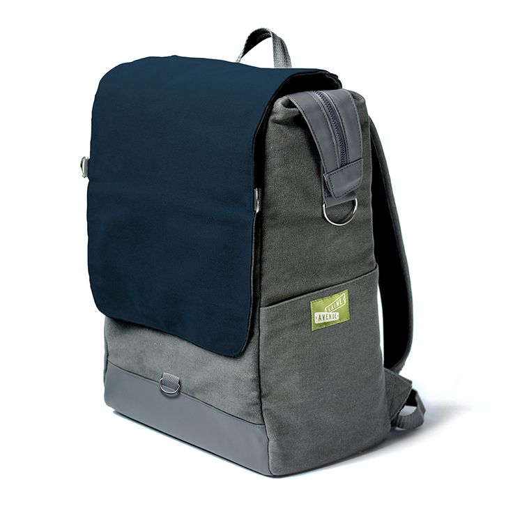 Dark as the bus stop in the morning. You are looking at the most unique backpack on the whole entire planet. Really. It's roomy. It holds all your stuff with our widemouth zip top. It protects your laptop or tablet with a padded sleeve, and best of all, The Crossbody Convertible Flap zips off to become a purse, (with the included cross body strap) for when you need just a few of your favorite things things and not all your stuff.