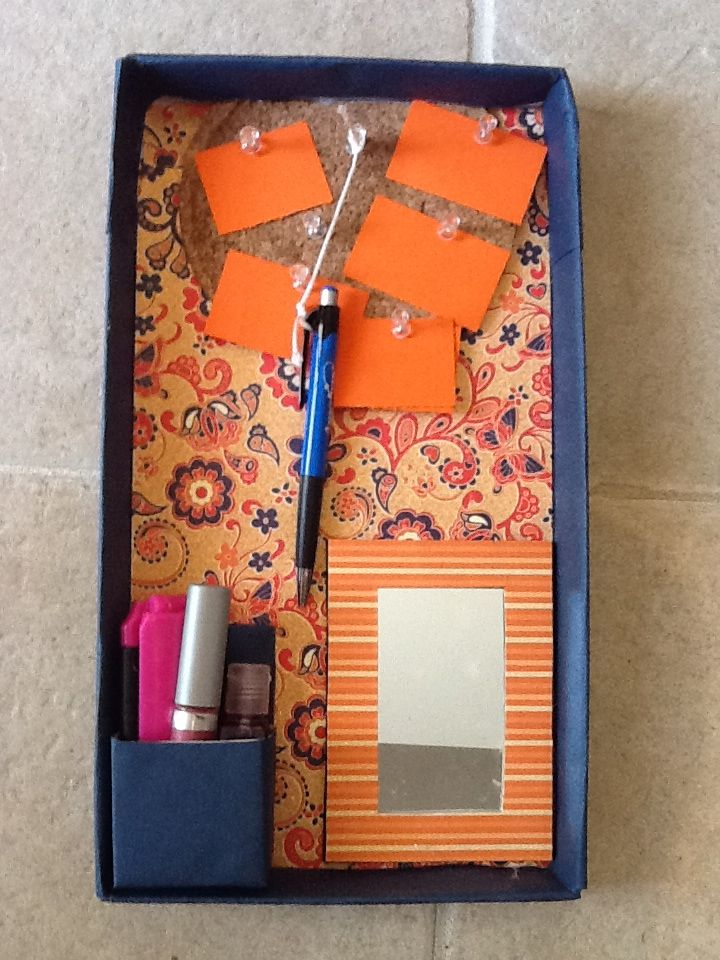 Locker organization! Made of shoe box lid and other finds around the house!