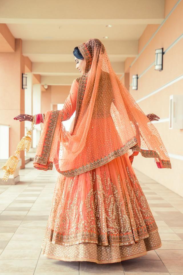 Bridal Lehengas - Pastel Orange Lehenga with Gold Zari Work, Sabyasachi Bridal | WedMeGood #wedmegood #brides #lehenga