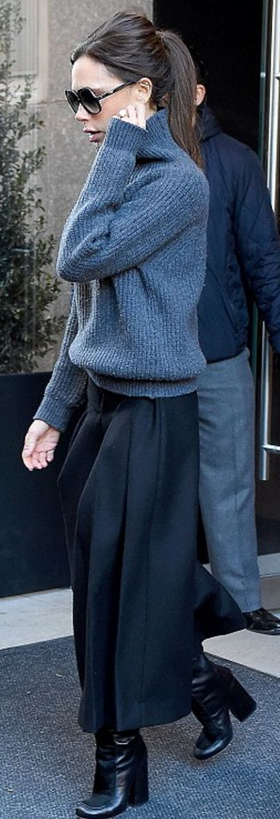 Who made  Victoria Beckham's gray sweater, black sunglasses, and pants?